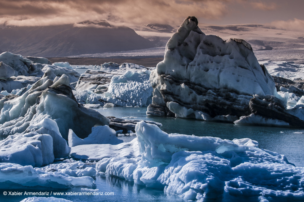 Icebergs floating in lake Jökulsárlón, Iceland. Formed by con